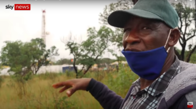 Andreas Mawano Limbundi shows Sky News how close ReconAfrica's test oil well is to his homestead.
