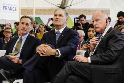 Washington Governor Jay Inslee (center) flanked by then-Vermont Governor Peter Shumlin (left) and California Governor Jerry Brown at the Paris climate summit in 2015.