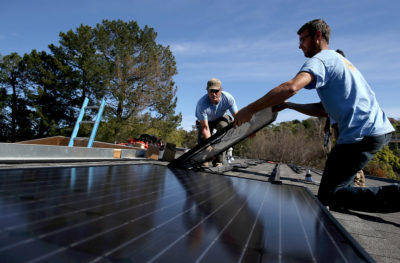 A solar panel is installed on the roof of a house in San Rafael, California.