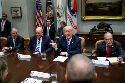 President Donald Trump at a meeting with auto executives, including Ford CEO James Hackett (seated to his left), at the White House in May 2018.