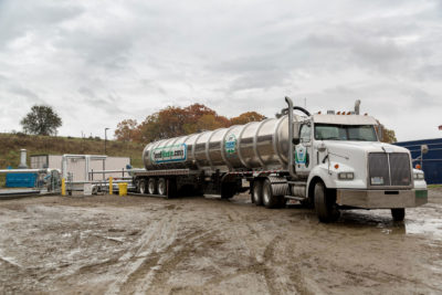 A truck delivers food waste to an anaerobic digester at a Massachusetts farm.