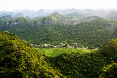A farming village surrounded by undeveloped forests in the province of Quang Ninh, Vietnam.