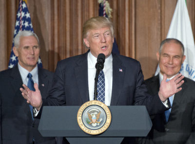 President Trump at EPA headquarters prior to signing an executive order rolling back U.S. climate change commitments. He is flanked by EPA Administrator Scott Pruitt (right) and Vice President Mike Pence.