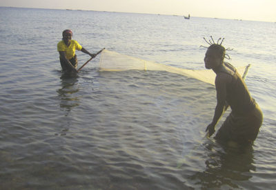 Women fish with a mosquito net, a practice that has contributed to overfishing.