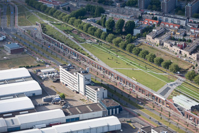 A multifunction dike in Rotterdam that serves as both a dike and commercial shopping area. Below the dike's grass-covered surface are shops that would be flooded if storm surges reach extreme levels.