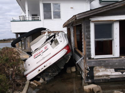 This bungalow owned by David Rinear off Long Beach Island, New Jersey, was totaled during Hurricane Sandy by an unmoored boat that crashed ashore.