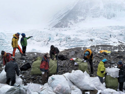 Climbers collect garbage near a base camp on Mount Everest.
