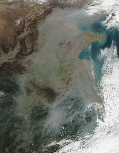 A thick blanket of smog over northeastern China in December 2016, the result of industrial emissions, energy generation, and crop burning.