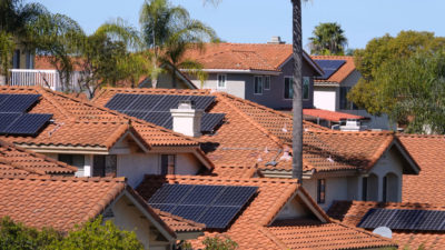 Solar panels on rooftops in California. The state has pledged to get all of its electricity from zero-carbon sources by 2045.