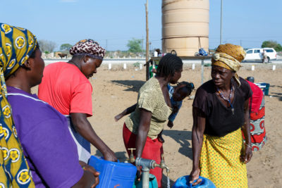 Women at a public drinking water tank in the Kavango region of Namibia, where water is scarce.
