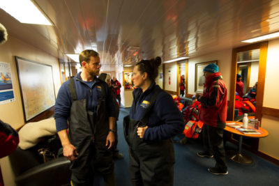 Marine scientist Holly Morin and a colleague from the University of Rhode Island wait to be transported off the Akademik Ioffe. The 36-member team of researchers were onboard to study the opening up of the Northwest Passage.