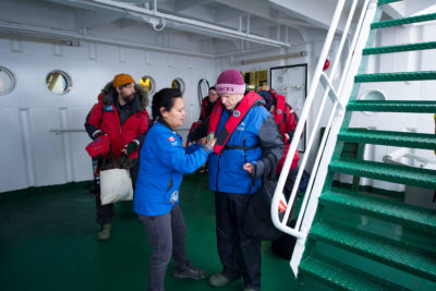 Akademik Ioffe passengers put on life jackets as they prepare to board the Zodiac rescue boats.