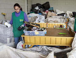 An EcoCitizen team member separates recyclables in one of the program's new warehouses.