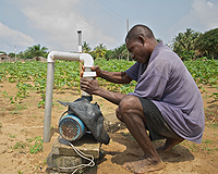 Ghana farmer uses water pump